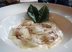 Pumpkin Ravioli in a Parmesan Fondue with a Red Wine Reduction