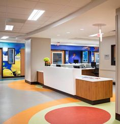 The pediatric nurses station features aqua wood flooring ...