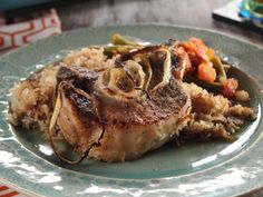Pork Chops and Rice : Trisha ensures that each element of her dish is full of rich, meaty taste by baking the pork chops, rice and fresh onions together in a single casserole. As the chops break down, they'll release their juices and flavor the dish from layer to layer.