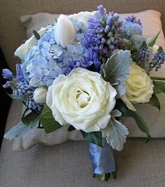 blue hydrangeas; grape hyacinths; hyacinths; roses; tulips; dusty miller
