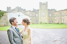 A bride wearing a 1980's heirloom wedding dress for her rainy day castle wedding