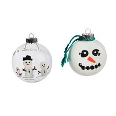kids made the snowman fingerprint ornaments in class...darling! Used dark blue balls with white pait and sharpied the faces on...