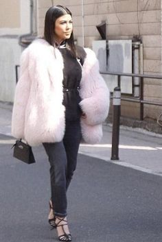 Kourtney Kardashian wearing Hermes Mini Kelly Bag and Prada Feather Trimmed Top