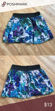 Blue/purple floral skirt Light lavender background with all over purple/blue floral print. Black waistband. Mimi Chica Skirts