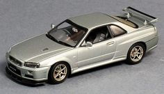 Nissan Skyline R34 GTR V-Spec II Diecast Car in Sparkling Silver. Manufacturer: Autoart 57332.  1:43 Scale diecast car.  Comes in a plastic display case. Click on the picture for more information about this diecast car!