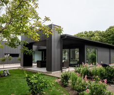 The clean look of Stria Cladding is the perfect complement to a home's modern landscaping House Cladding, Cladding Panels, Exterior Cladding, Facade House, House Exteriors, Cladding Ideas, Black Exterior, Exterior Design, Cafe Exterior