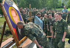 "Russian soldiers line up to kiss an ""icon"" of Putin, while a Russian Orthodox priest of the Moscow Patriarchate blesses them. (Image: Social media)"