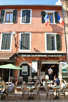 Cassis -- A pastel colored bar with flags festooned on the top floor