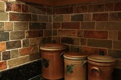This is a slate backsplash using California Gold multi-sized brick tiles.