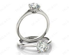 Brilliant Cut Four Claw Set Diamond Ring With a Plain Band.