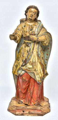Imagem de Santa Luzia entalhada em madeira, policroma e dourada. Minas Gerais, último terço do século XVIII. De acordo com Erick Marques Ferreira, esta imagem é de autoria de mestre Valentim Correa Paes. Imagem erudita realizada em conformidade com os pressupostos do rococó,