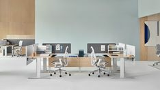 Canvas Vista is featured in this setting with shared lower storage and Motia Sit-to-Stand Tables. These products reduce the size of workstation footprints and help people move between sitting and standing postures throughout the day. Lift Table, Hanging Chair From Ceiling, Sit To Stand, Office Workstations, Small Space Organization, Maximize Space, Clever Design, Wall Canvas, Living Room Chairs