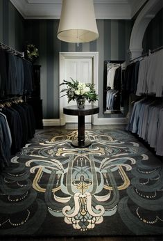 A marvelous use of art deco in a gentlemens closet.