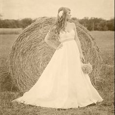 This photo was created by RED-DER photos by Cindy King.  Visit RED-DER at www.redderphotos.com and www.facebook.com/redderphotos Hay bale back drop for rustic bridal shoot :)