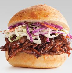 Do a little DIY for your graduation party. All you need is a platter of toasted buns, a slow cooker full of BBQ beef and some coleslaw for topping. Can't get much easier - or better - than that.