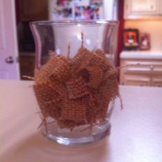 """Burlap """"rose"""" on a hurricane globe. Total project, less than $2.00 each. Just burlap and hot glue."""