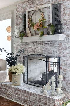 My Spring mantle is bursting with florals, greenery, soft blush and layers of vintage elements. See more My Spring mantle is bursting with florals, greenery, soft blush and layers of vintage elements. See more at DIY beautify! Brick Fireplace Makeover, Home Fireplace, Fireplace Remodel, Living Room With Fireplace, Fireplace Design, Fireplace Hearth Decor, Fireplace Ideas, Mantel Ideas, Farmhouse Fireplace
