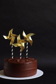 Brass pinwheel cake toppers