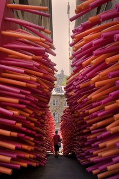 Hundreds of pool noodles invaded an abandoned alley in Quebec City, Canada as part of Delirious Frites, an architectural installation created by Les Astronautes.