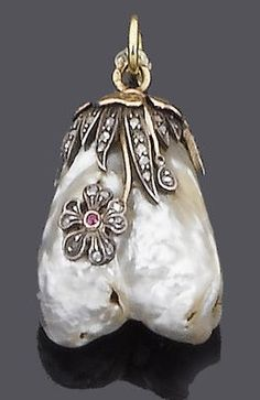 A late 19th century diamond, ruby and baroque pearl pendant, circa 1880. The baroque pearl pendant with applied rose-cut diamond flowers and leaves with circular-cut ruby detail, to a polished yellow gold leaf surmount, mounted in silver and gold, French assay marks.