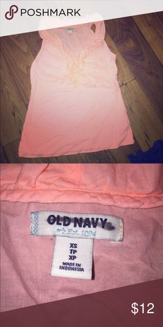 "Ruffle tank top Peach colored ruffle tank top. From old navy, purchased at the store but was ""damaged"" since it was an online return and that is why the old navy is x'd out. Old Navy Tops Tank Tops"