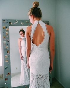 The open back and lace details on this prom dress make this Alana's ideal look for prom this year! Shop this dress and more at David's Bridal | Photo via @alanabaer