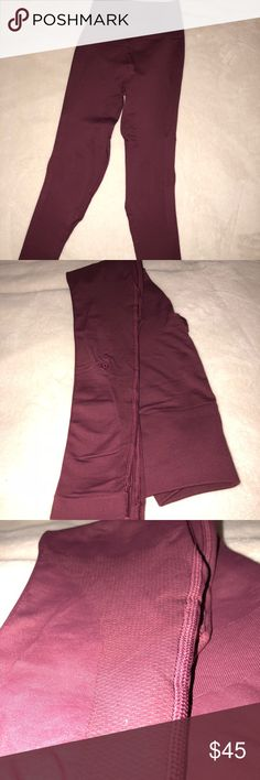 Lululemon Compression Leggings Maroon Size 2 Lululemon Maroon Compression Leggings / Contoura Lower body with flattering Ribbing under the bum, inner and outer thighs and a high waist band that's SUPER flattering lululemon athletica Pants Leggings
