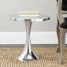 @Overstock - An updated iteration of the classic Saarinen table, the Galium table's hour glass base looks fresh and new in a polished aluminum finish.http://www.overstock.com/Home-Garden/Safavieh-Galium-Silver-Side-Table/7388202/product.html?CID=214117 $160.69