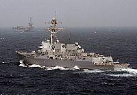 The Arleigh Burke-class guided-missile destroyer USS Momsen (DDG 92) arrives alongside the Nimitz-class aircraft carrier USS Carl Vinson (CVN 70).