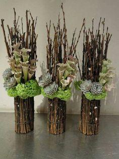 Pitcher, hydrangea and dried stick arrangement