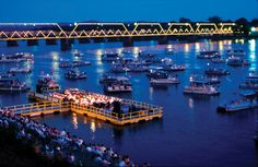 The Harrisburg Symphony Orchestra plays for an audience on shore and in boats at a concert on the Susquehanna River. Harrisburg Pennsylvania, Orchestra Concerts, Susquehanna River, What Is Great, World Cities, Night Life, The Neighbourhood, Places To Go, Beautiful Places
