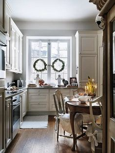 love the feel of this kitchen - it's serene and french, cozy and classic - clean traditional small kitchen