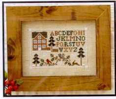 The cross stitch pattern by Little House Needleworks is stitched with DMC threads. A delightful cross stitch pattern with woodland motifs around a house and the alphabet for the sampler touch!