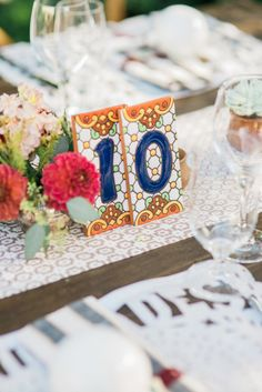 Mosaic tiled table number: http://www.stylemepretty.com/collection/2508/ Photography: Ether and Smith - http://etherandsmith.com/