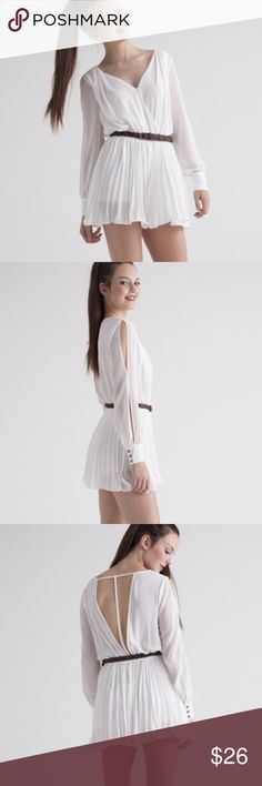 """Shake Shake It White Romper The party won't start until you walk in wearing this white pleated romper. This romper is flowy all around which makes it the perfect outfit for dancing. The billowing sleeves have slits in sides and end with a button cuff at the wrists. The back opens all the way down to the braided brown belt. Add some heels and dance the night away.  Materials: 100% Polyester Approx. Measurements (Size S): 30"""" top to hem, 30"""" bust Double Zero Other"""
