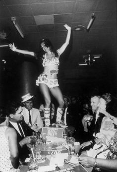 Go-go girl and delegates during the 1968 Republican National Convention, Miami Beach, Florida. (Lynn Pelham—Time & Life Pictures/Getty Images)