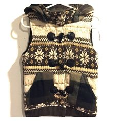 Winter vest Sweater vest worn once. Detachable hood with toggle closure. Great condition Sweaters