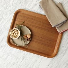 This Wood Tray in a dark finish is perfect for serving cocktails, tea, or food. Its curved edges and smooth wood grain complement countertops, or use it to organize odds and ends on dressers and coffee tables.