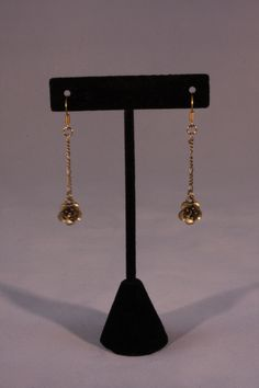 Gold flower drop earrings. Mountain Laurel Boutique