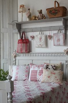 Cottage decor in white and red. I like the spindles on the white painted bed.