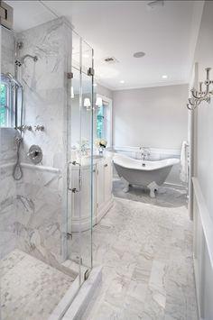 Bathroom. Classic Bathroom Design. Marble tiling gives a timeless feel to this bathroom. #Bathroom #BathroomDesign