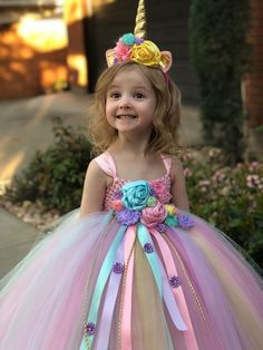 Our Enchanted Unicorn dress is perfect for your little ones birthday party, Halloween costume, photo shoot, etc! It features an empire waistline with gorgeous satin and fabric flowers. Horn headband is included!!! You can send me custom colors if you'd like! I can do any variations of