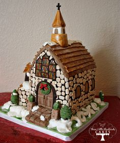 This is a cake, but the decorating ideas could easily be replicated for a gingerbread house. The stained glass windows are stunning!
