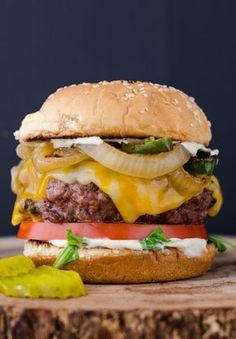 The Ultimate Juicy Burger is a mouth watering, cheese oozing, and grease dribbling extravaganza. This recipe will teach you how to make the perfect burger. Fire up those grills for Labor Day and let's chomp on some delicious ground chuck. I'm not messing Burger Dogs, Beef Burgers, Good Burger, Burger On Grill, Juicy Burger Recipe, Sandwich Recipes, Standard Burger Recipe, Beef Recipes, Snacks