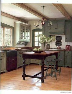 Cottage Kitchen with Farmhouse Sink & Stone Tile