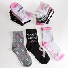 Assorted Breast Cancer Awareness Socks by Century Novelty. $2.98. Show your Courage and Strength! The pink ribbon socks are perfect for your next Breast Cancer Awareness event. These pink ribbon socks make great inspirational giveaways. Pair of Women's 9 11 socks. Assorted styles. 85% acrylic 10% nylon, and 5% spandex. These party favors are perfect for your next Breast Cancer awareness fundraiser or event. Part of Events > Pink Ribbon & Breast Cancer Awareness > Favors, Toys, Gifts