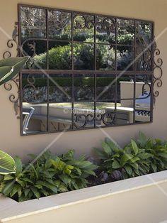 Transforming plain garden walls to create functional outdoor rooms