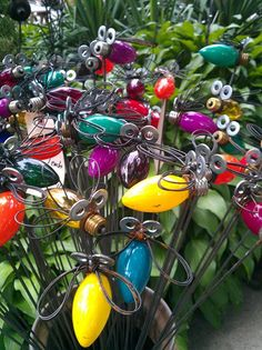 Lightning bug garden stakes made from wire Christmas bulbs and washers