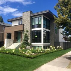 new construction modern architecture wood stucco and stone exterior