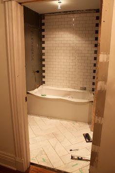 Herringbone tile floor for master bath